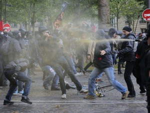 Demonstrators, left, clash with Unions security men during a protest against Labor Law as the Socialist government decided to force the bill through Parliament without a vote, in Paris, Thursday, May 12, 2016. France's government is facing a major test as lawmakers hold a no-confidence vote, prompted by a deeply divisive labor law allowing longer workdays and easier layoffs.(AP Photo/Christophe Ena)/XENA110/16534364394/1605121638